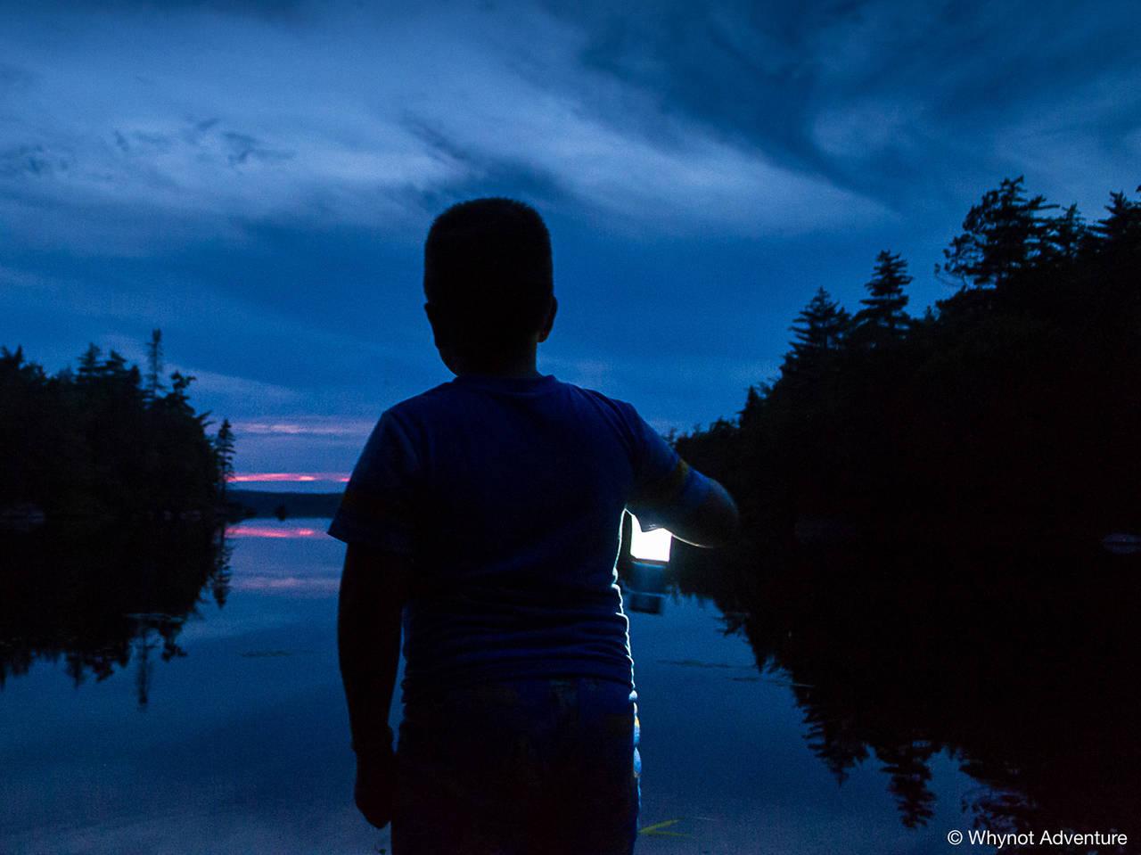 Lake, lantern and lad